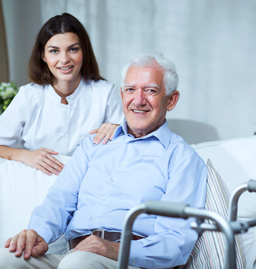 elderly man with a caregiver
