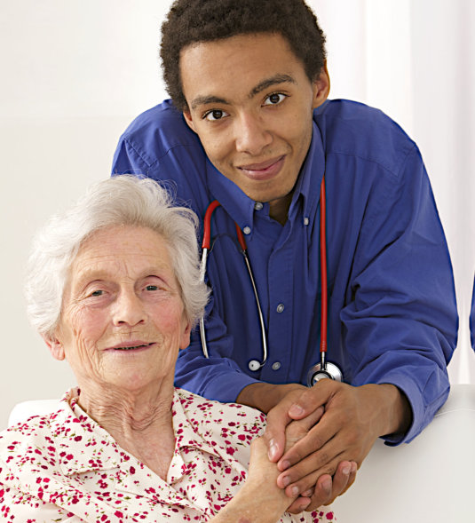 young man holding the hand of an old lady